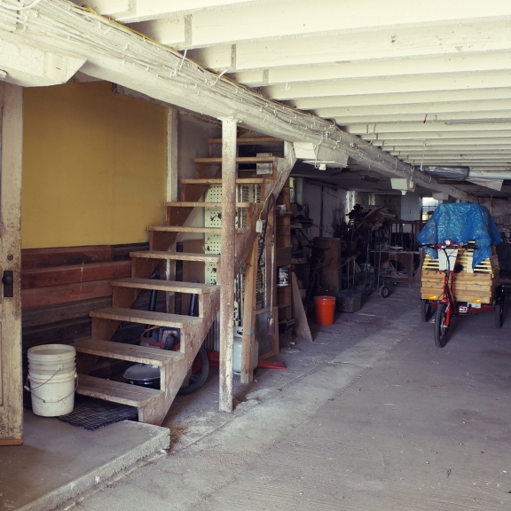 The main floor of the barn is a lot of storage. The stairs lead to the second floor, where I live, and that door goes into the kitchen.